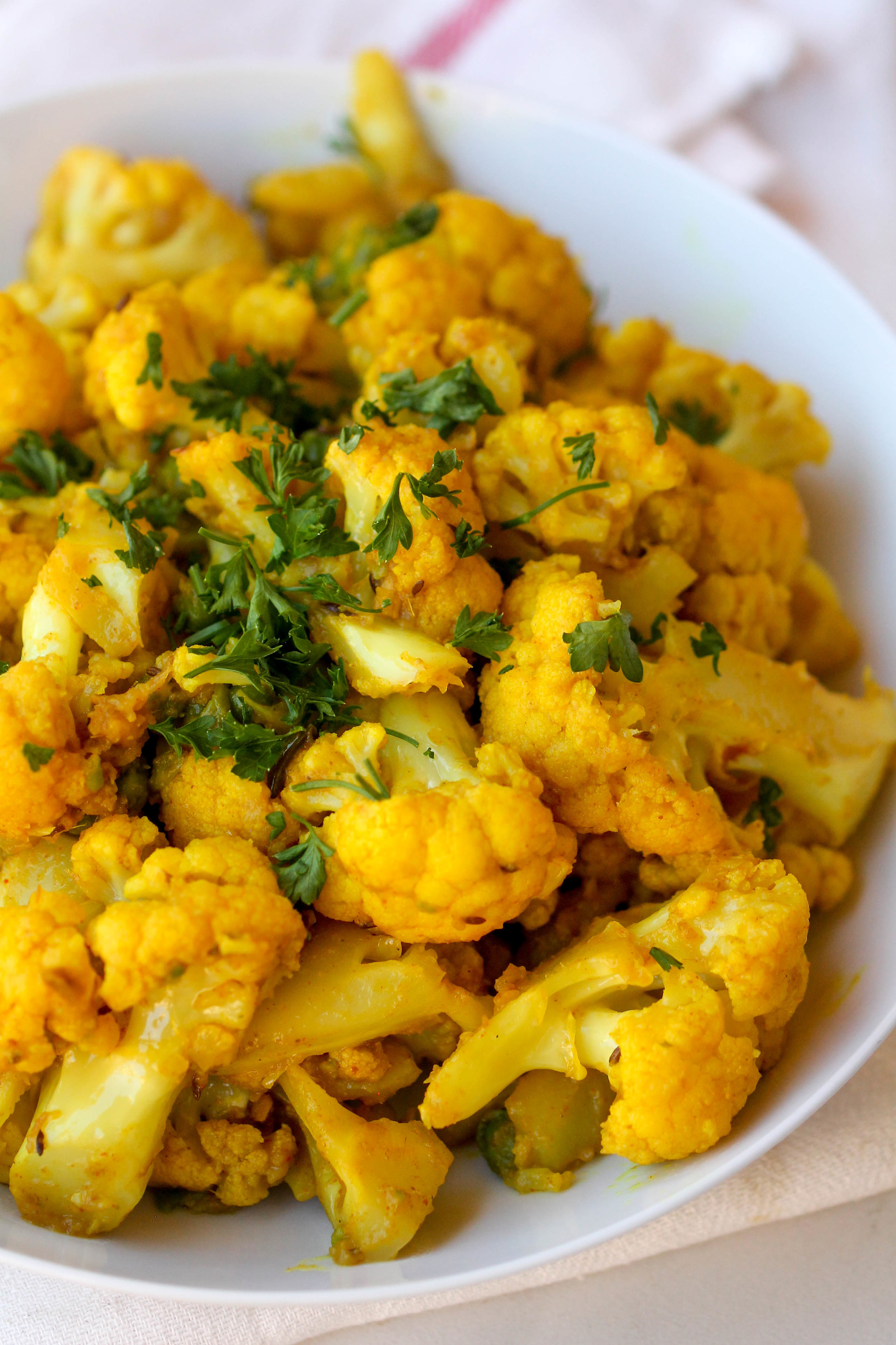 Cauli Aloo is a one pot vegetarian/vegan/gluten-free side dish that can be made under 30 minutes.