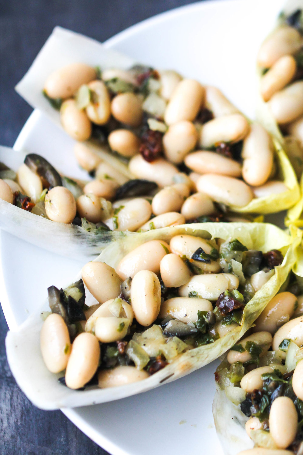 Cannellini Bean Salad with Basil and Sun-Dried Tomatoes makes a lovely light lunch or can be enjoyed as a refreshing side, or take it to a picnic, potluck. It is naturally vegan & gluten-free.