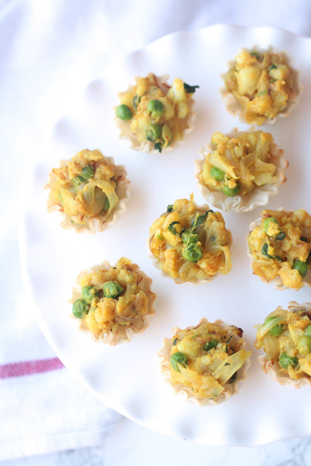 Samosa Bites - Go-to appetizers for parties and potlucks because they are super quick to put together + meet vegetarian & vegan lifestyle + everyone loves bite-sized food, no? Click here for the recipe!