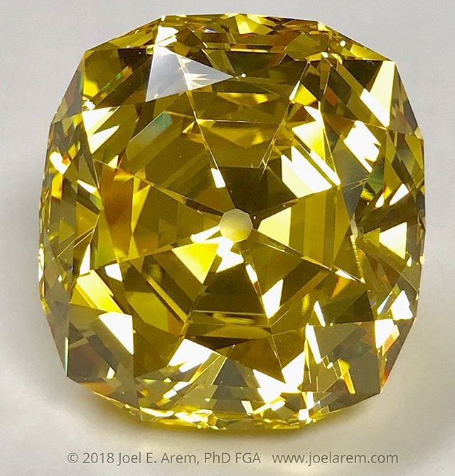GGG, gadolinium gallium garnet, 224.0 carats, made in the 1970s.  GGG, YAG, YIG and others are not garnets (which are minerals) but rather compounds with the garnet structure, and which do not exist in nature. These materials were originally grown for use in lasers and electronics, and have been manufactured for many years on a large scale. YAG (yttrium aluminum garnet) and GGG (gadolinium gallium garnet) were cut as gems as early as the 1960s. YAG was the most popular diamond simulant in the 1960s and early 1970s, eventually displaced after 1976 by cubic zirconia, which had much more of a diamond-like appearance. YAG and GGG were produced in more than a dozen colors, created by doping with various rare earth elements. But gadolinium is much more expensive than yttrium, and GGG turns brownish when exposed to UV light, so even its high dispersion was insufficient to sustain its popularity. Large fine cut gems like this one are extremely rare and have become collectibles in their own right. #www.joelarem.com#syntheticgem#laboratorygem#simulant#fashion#jewelry#beauty#gemphotography#laboratory#growngems#www.eurekaeureka.etsy.com#etsyseller#synthetics#Czochralski#crystalgrowth#science#manmade#crystals
