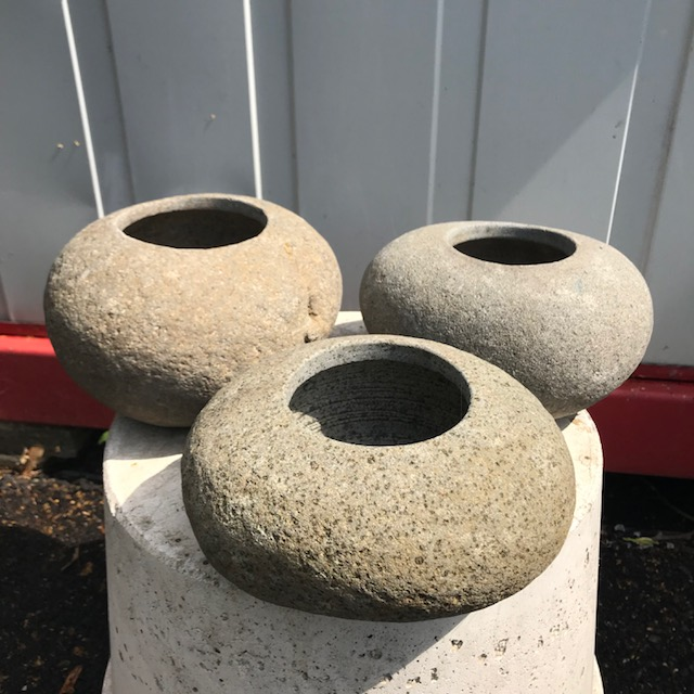 River stone flower pots with a hole in the bottom