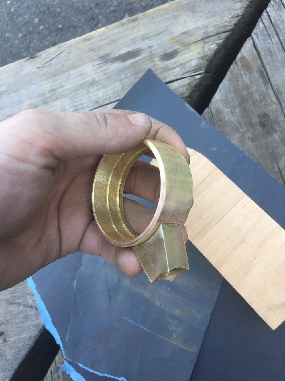 The magnifying glass required multiple manufacturing processes. The handle, ring, and lens were turned on the lathe, the lug was machined on the mill, and finally the lug and ring were attached through brazing.