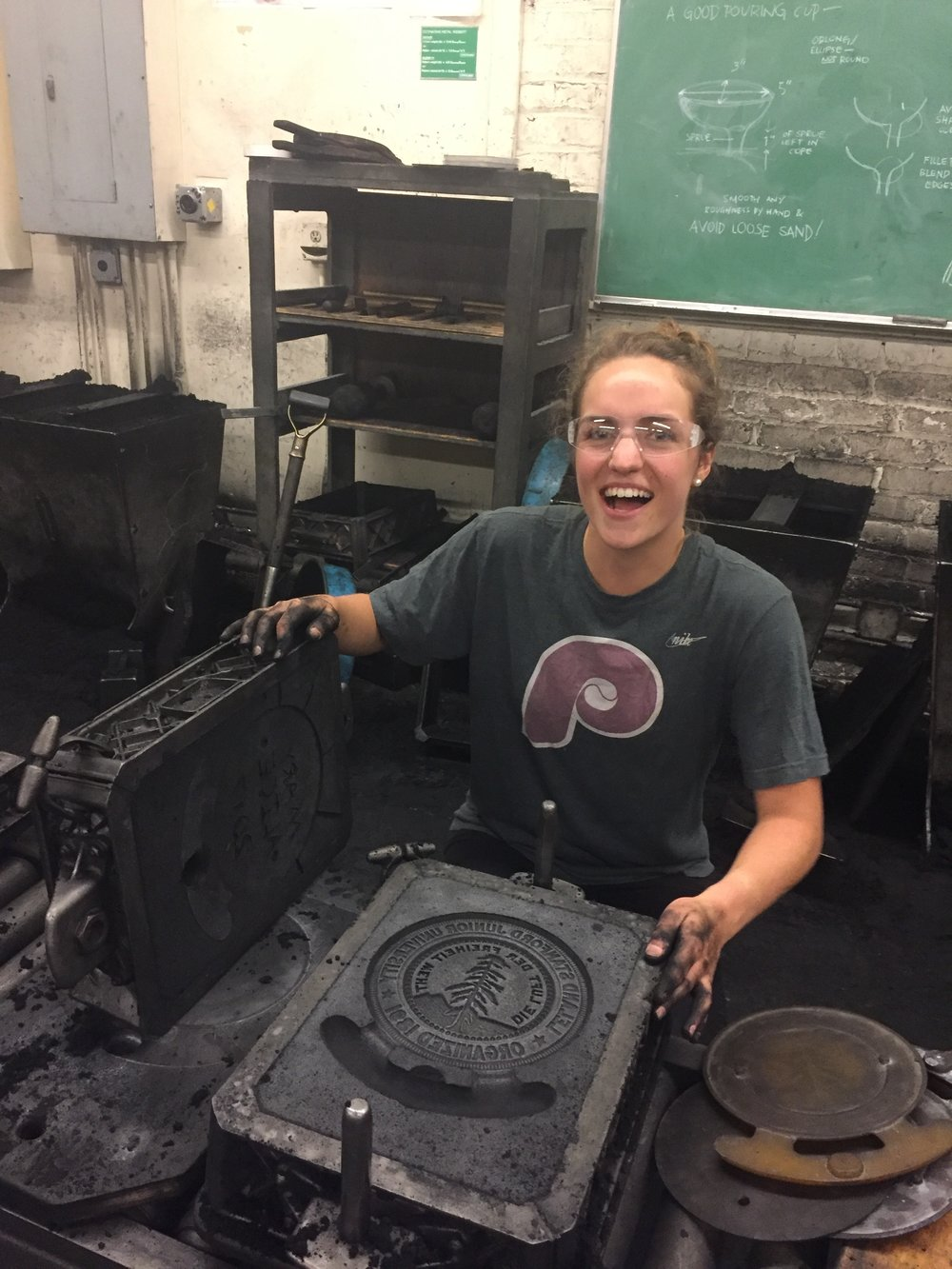 The Stanford Seal was my first sand casting project. Since the molds are heavy, you need a partner to help you lift and turn the sand molds (as my peer Greta demonstrates). I mastered the process of ramming up a mold and paid attention to manufacturing process limitations, such as wall thickness and strategically placing a gate and runner for the metal to flow into.