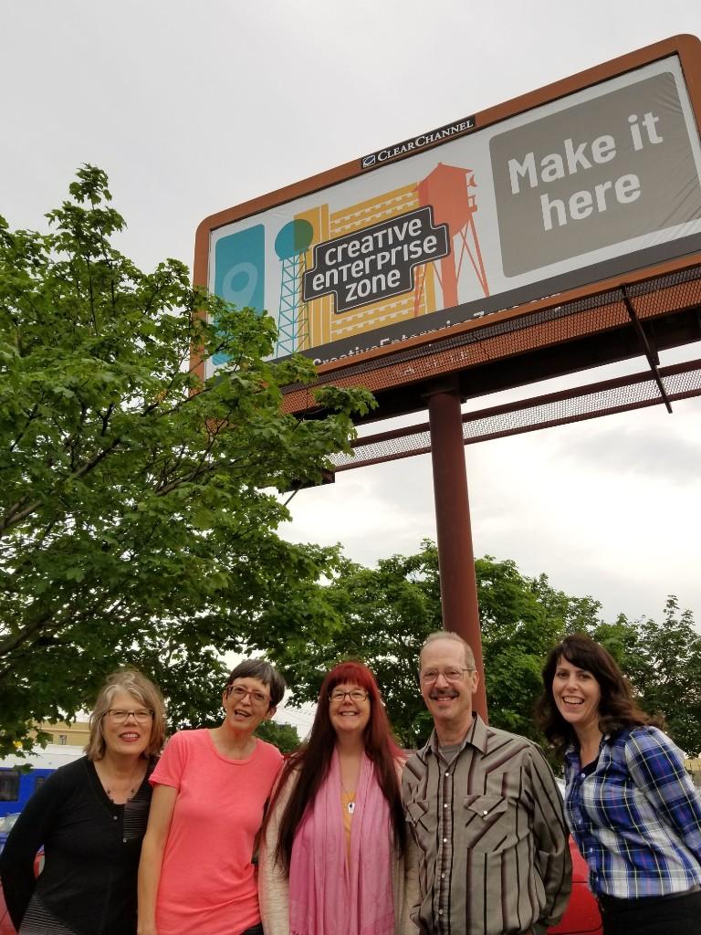 The billboard team, from left: CEZ board members Catherine Reid Day (chair), Pat Thompson, Julie Ann James, and Jack Becker; and CEZ coordinator Erin Heelan.