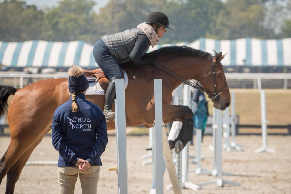 Caitlyn Shiels, pictured teaching a lesson in Ocala, FL, will begin accepting a limited number of students as she expands True North Stables. Photo by     Fine Art Horses