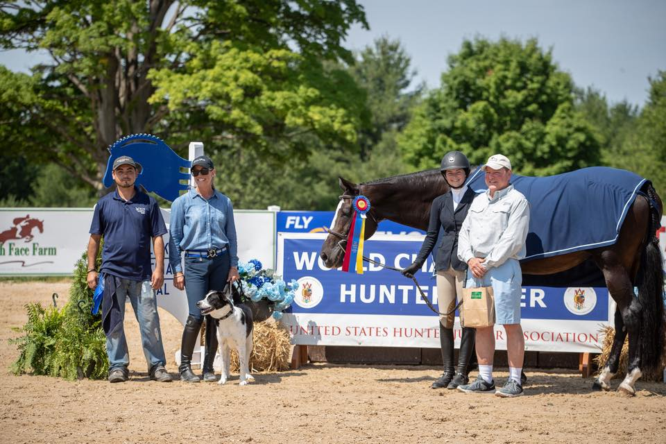 Hannah Hoch and Clear Sailing accepting their Large Junior 15 & Under Hunter championship!