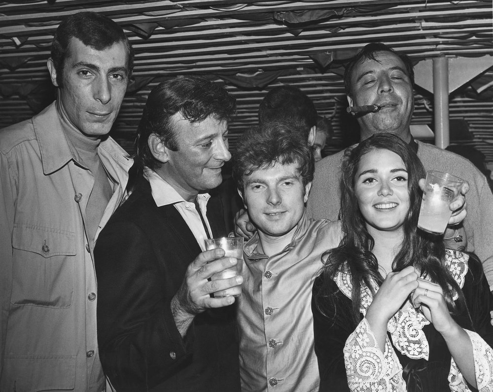 "(l to r) Jeff Barry, Bert Berns, Van Morrison, Carmine ""Wassel"" DeNoia (with cigar), and Janet Planet at a Bang Records promotional party held on a boat on the Hudson River in New York City, 1967."