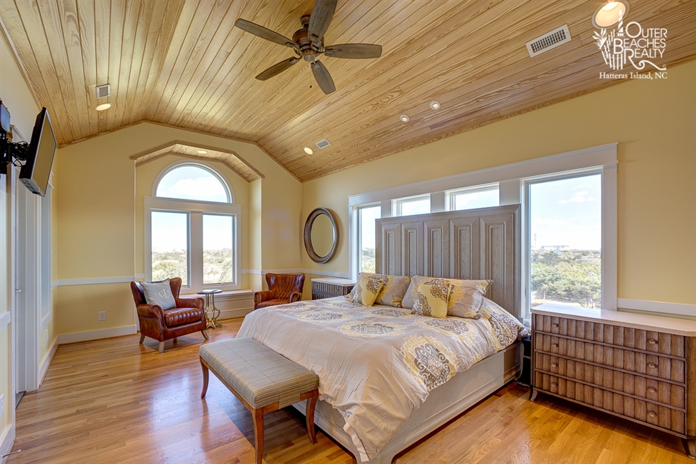 FREEDOM - The only room located on the third level, this master bedroom is actually a master suite. This spacious room contains a king-size bed, an expansive, private bathroom with heated floors and whirlpool tub as well as its own private balcony and washer/dryer.