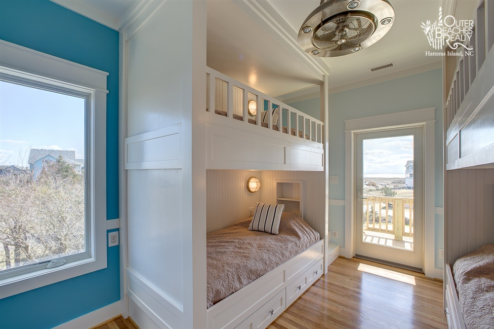 HARMONY - Situated on the second level, this shared bedroom contains two sets of bunk beds and its own bathroom for just you and your roommate, Tina, our lovely cook. It's equipped with built-in staircases for the top bunk and deck access with a stunning ocean view.