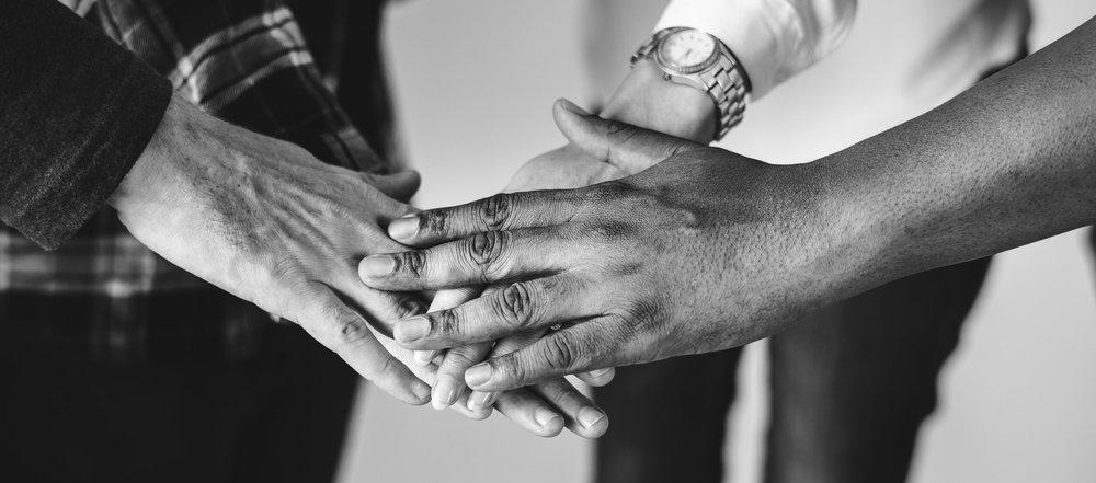 diverse-people-joining-hands-together-teamwork-PZ6DXKN.jpg