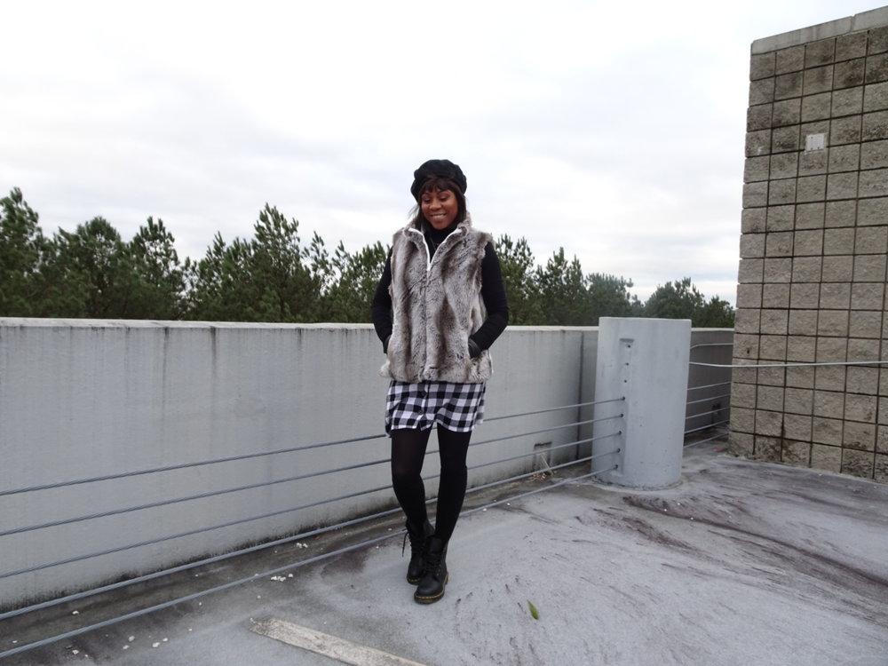 Hat: Thrift; Turtleneck: ASOS; Faux Fur Vest: Vintage; Skirt: ASOS; Boots: Doc Martens