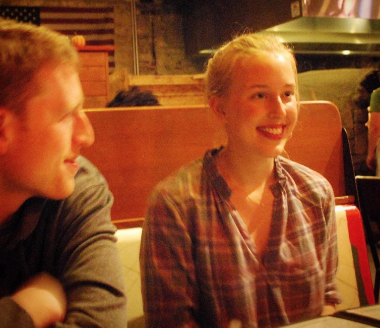 A vintage moment - Meg sees our pizza coming to the table while I'm still oblivious