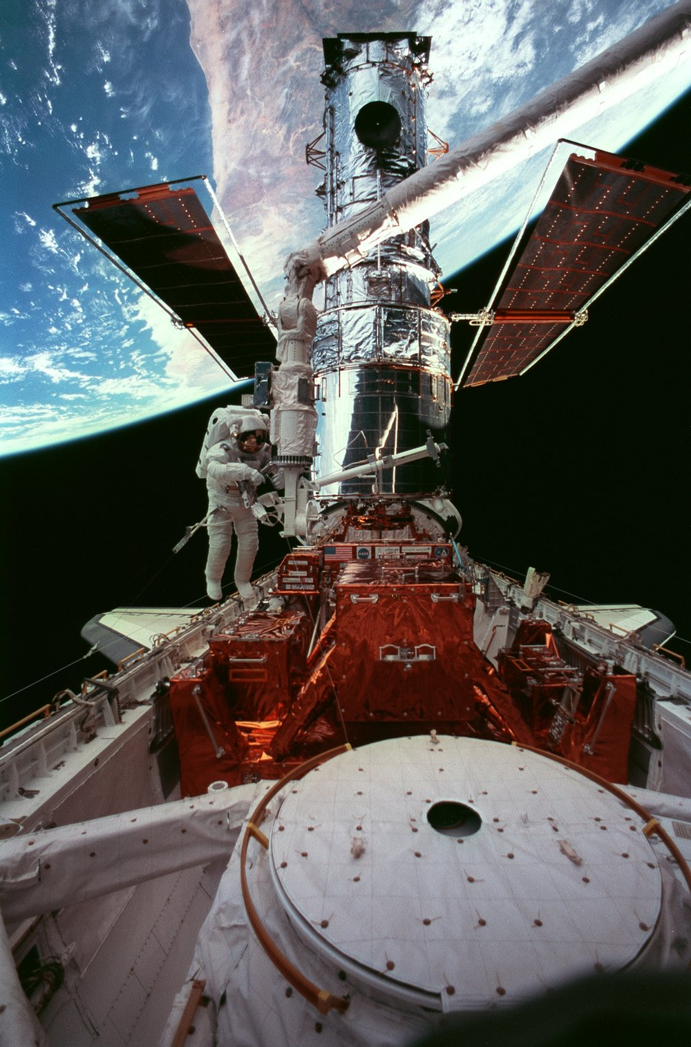 Spacewalk with Hubble and gorgeous Earth