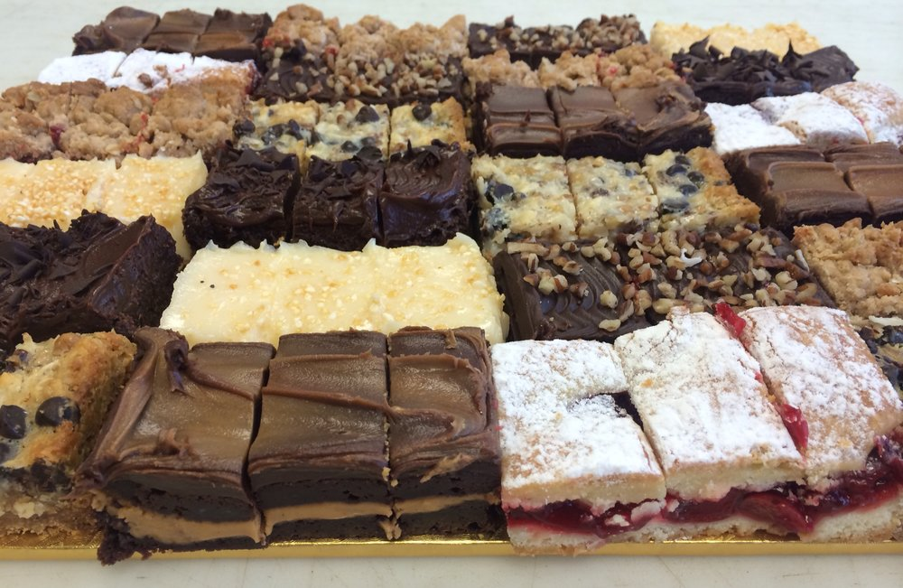 Brownie and Bar Tray - A nice variety of our brownie and bars including cherry squares, lemon crunch bars, hello dollies, brownie cheesecake squares, double fudge brownies, peanut butter brownies and chewy brownies.1/4 Sheet (36 pieces) $49.001/2 Sheet (72 pieces) $91.00