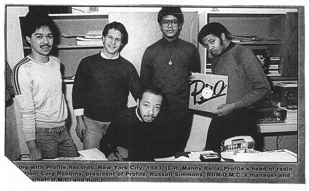 Signing with Profile Records, New York City, 1983, (L-R: Manny Bella, Profile's head of radio production: Cory Robbins, president of Profile; Russell Simmons, RUN-D.M.C.'s manager and D.M.C. and Run.)