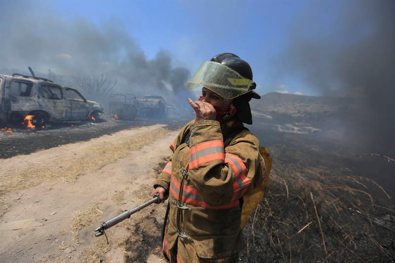 Mueren dos de los cinco bomberos hondureños quemados sofocando un incendio forestal .jpg