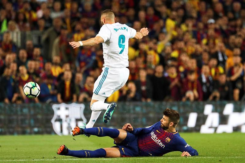 Gerard Pique y  Karim Benzema .jpg