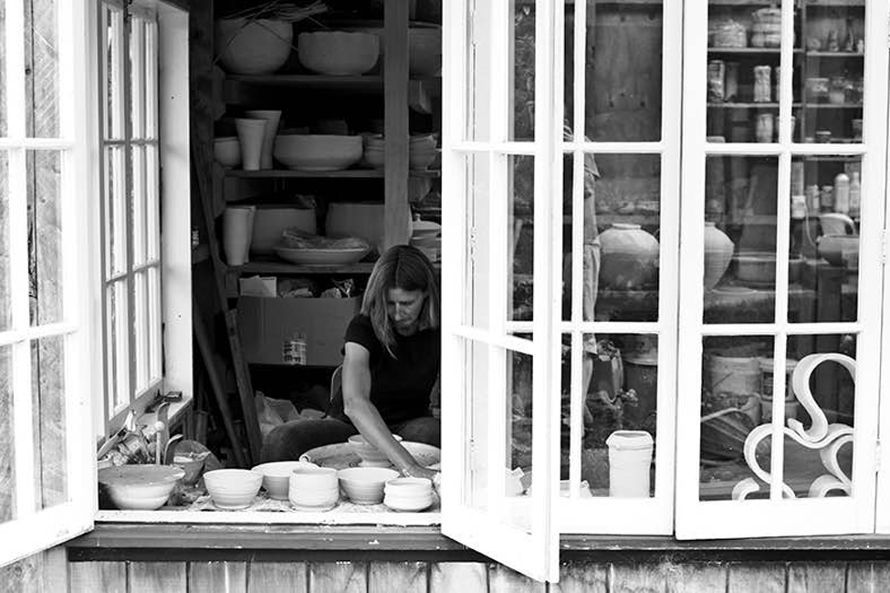 Elena Renker - Elena was born in Germany and was first introduced to Pottery in 1977 at the Golden Bridge Pottery run by Ray and Debra Meeker in Pondicherry, India. Elena now lives on a farm north of Auckland which gives her the opportunity to use clay from her own land. Her focus has been on making shino glazed bowls and cups - by faceting the exterior of the pot, Elena opens up the clay and exposes all it's impurities to create an interesting surface for the shino glaze to interact with. The iron oxide decoration provides an extra focal point.