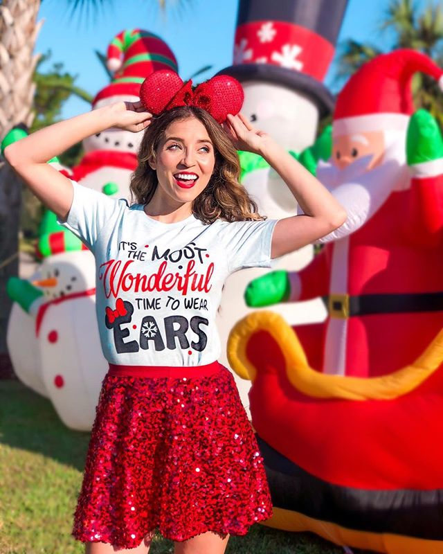 It's the most wonderful time to wear ears❤️🎄 * * * I love this shirt from @magicandmiceco so much because nothing's better than Mickey ears! 🐭I paired the tee with this sparkly red skirt from @target which is perfect for the holidays! ✨✨ * * * * Speaking of the holidays, I've now begun my Christmas tradition of watching Christmas movies & eating tons of cookies! What are your Christmas traditions?🎄⛄️ * * * * * * * * * #target #targetstyle #christmas #disneychristmas #disneyblogger #instadisney #disneyinsta #disneyparks #disneystyle #disneylove #disneylife #disneyfashion #fashionblogger #wdw #disneyigers
