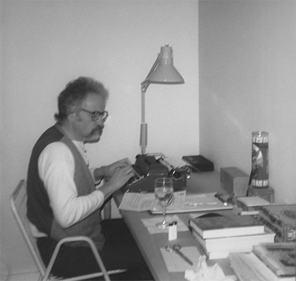 David working in his office, 1985