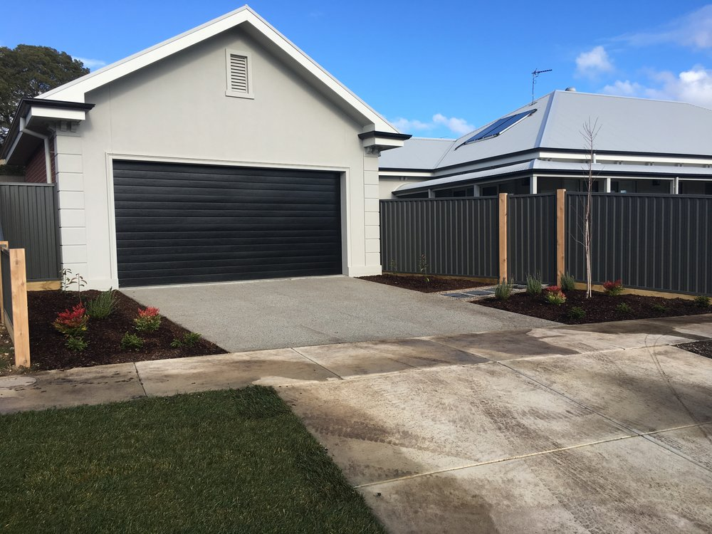 Garden beds and exposed aggregate driveway pad