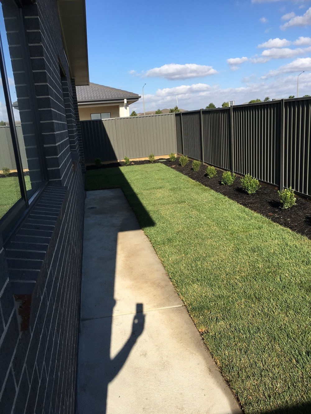 Instant turf and garden bed with black mulch