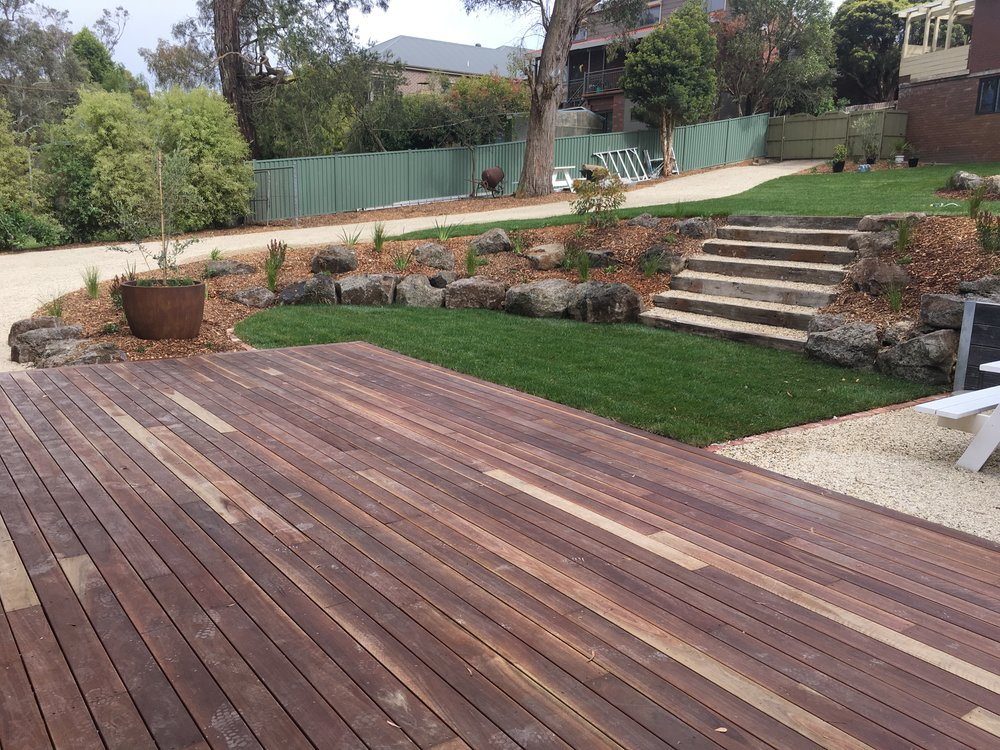 Deck, steps, garden beds with rocks as edging, instant turf and lilydale toppings pad