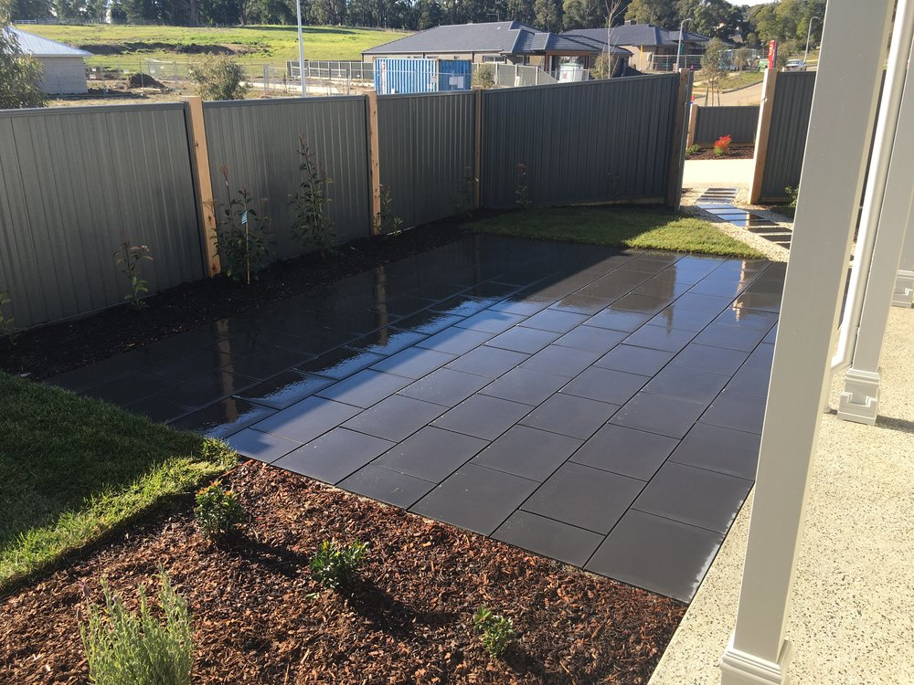 Paved area in stretcher bond style, mulched garden bed and instant turf