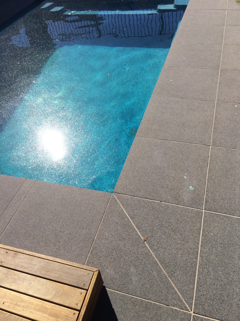 Paving around pool in stack bond style