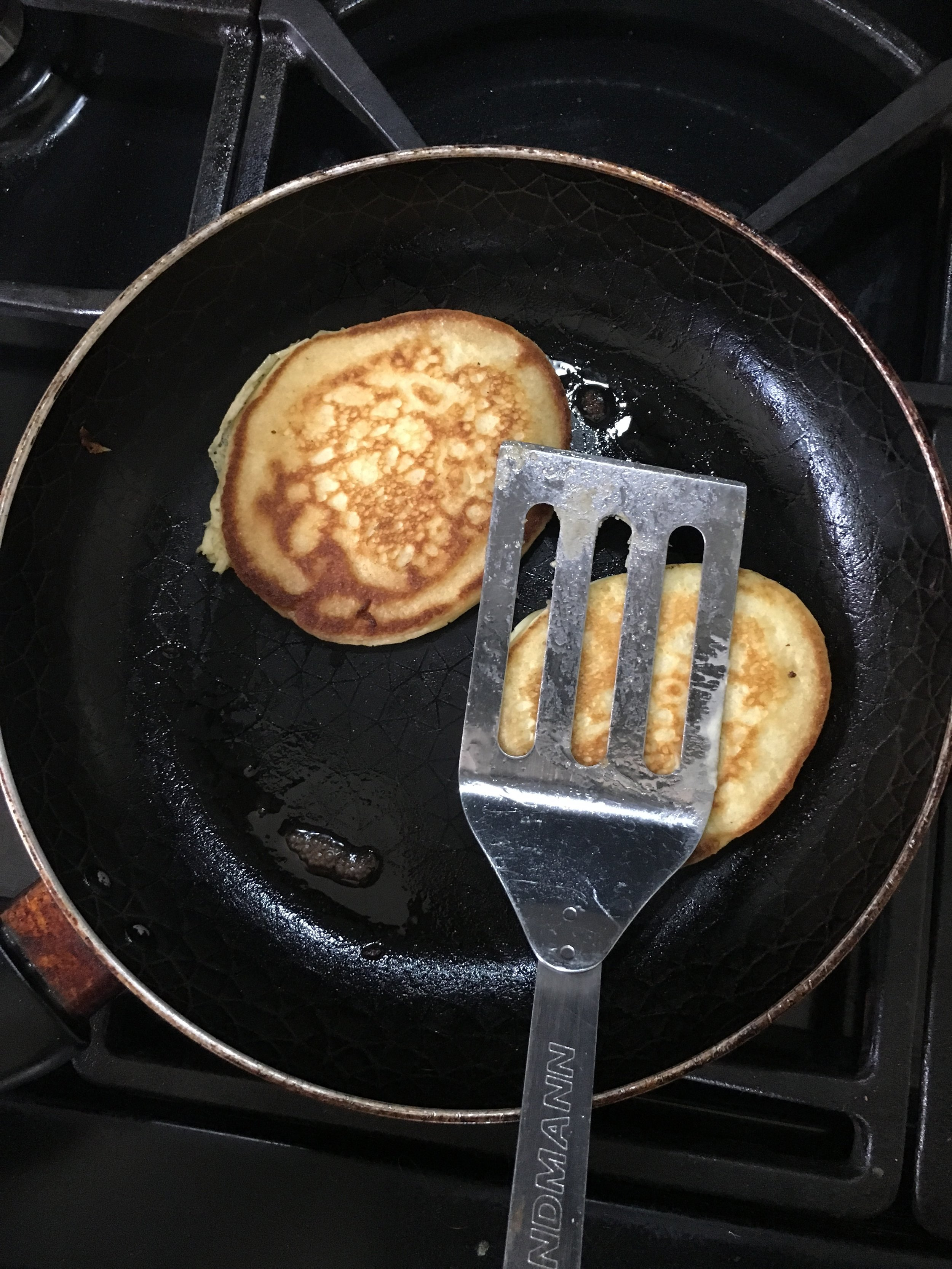 Squash the pancakes a little with a fish slice