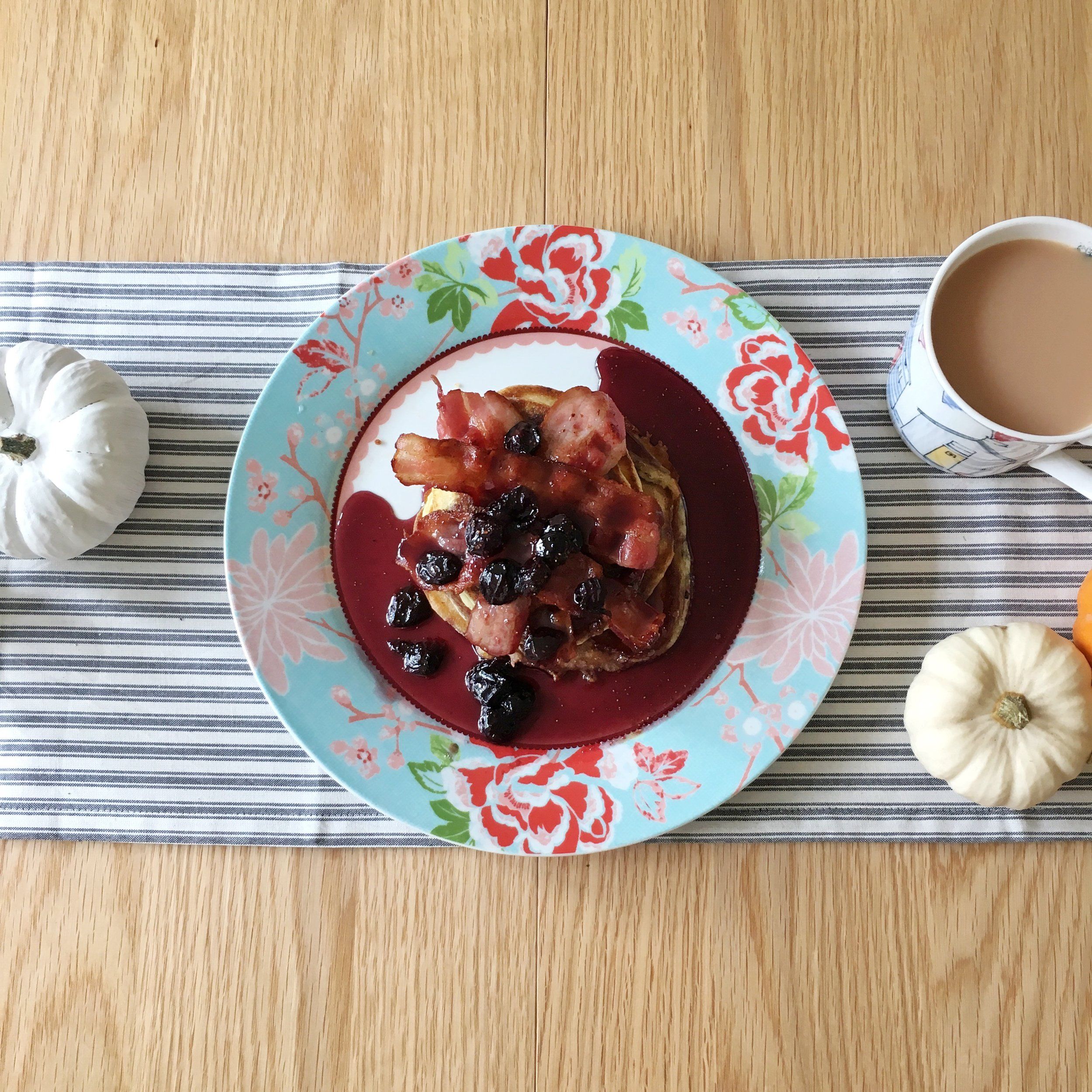 Gluten free pancakes with blueberry maple syrup and bacon