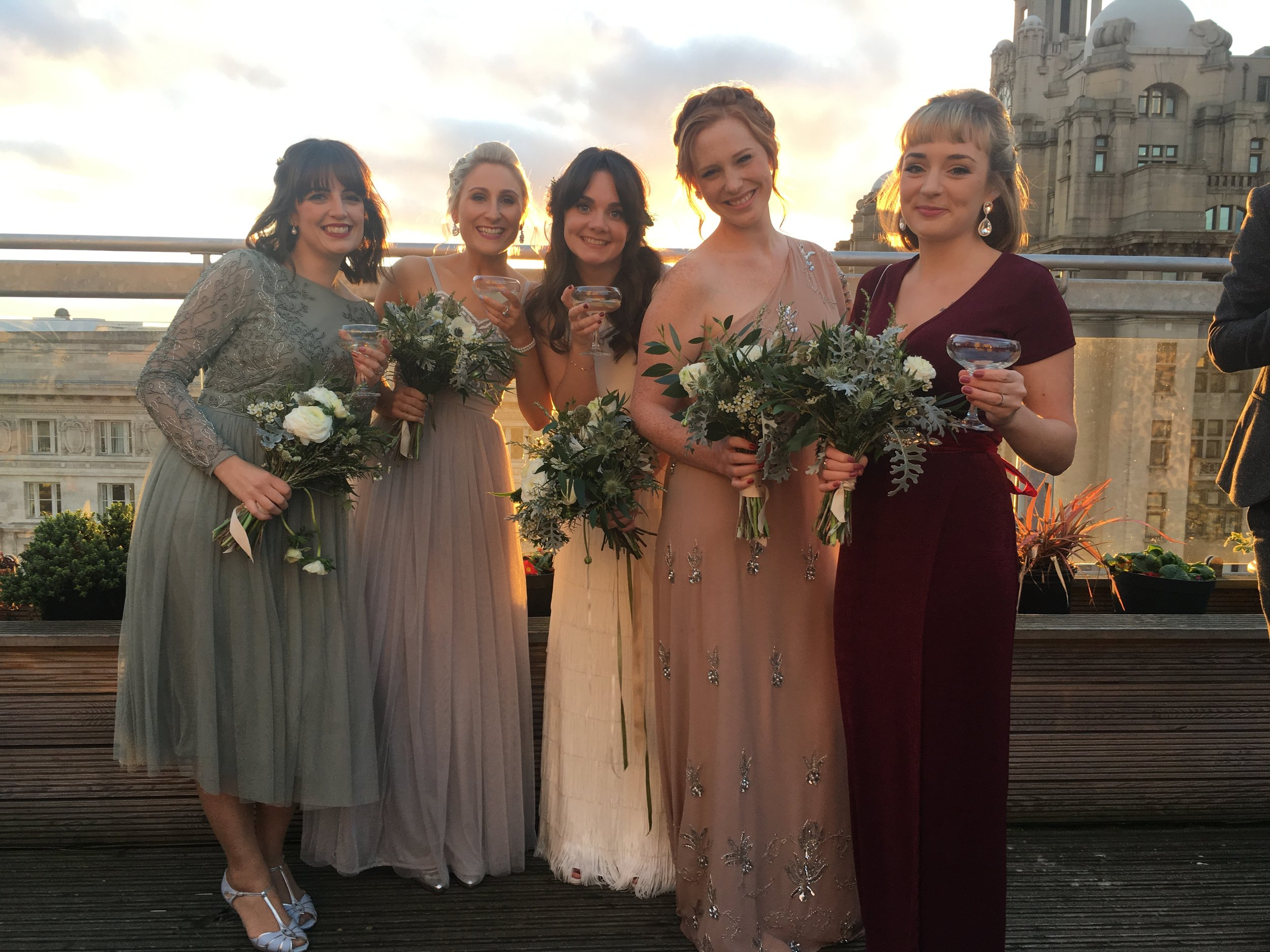 Bridesmaids and bride together on the rooftop terrace at Oh Me Oh My, Liverpool. Pinafores and Peonies