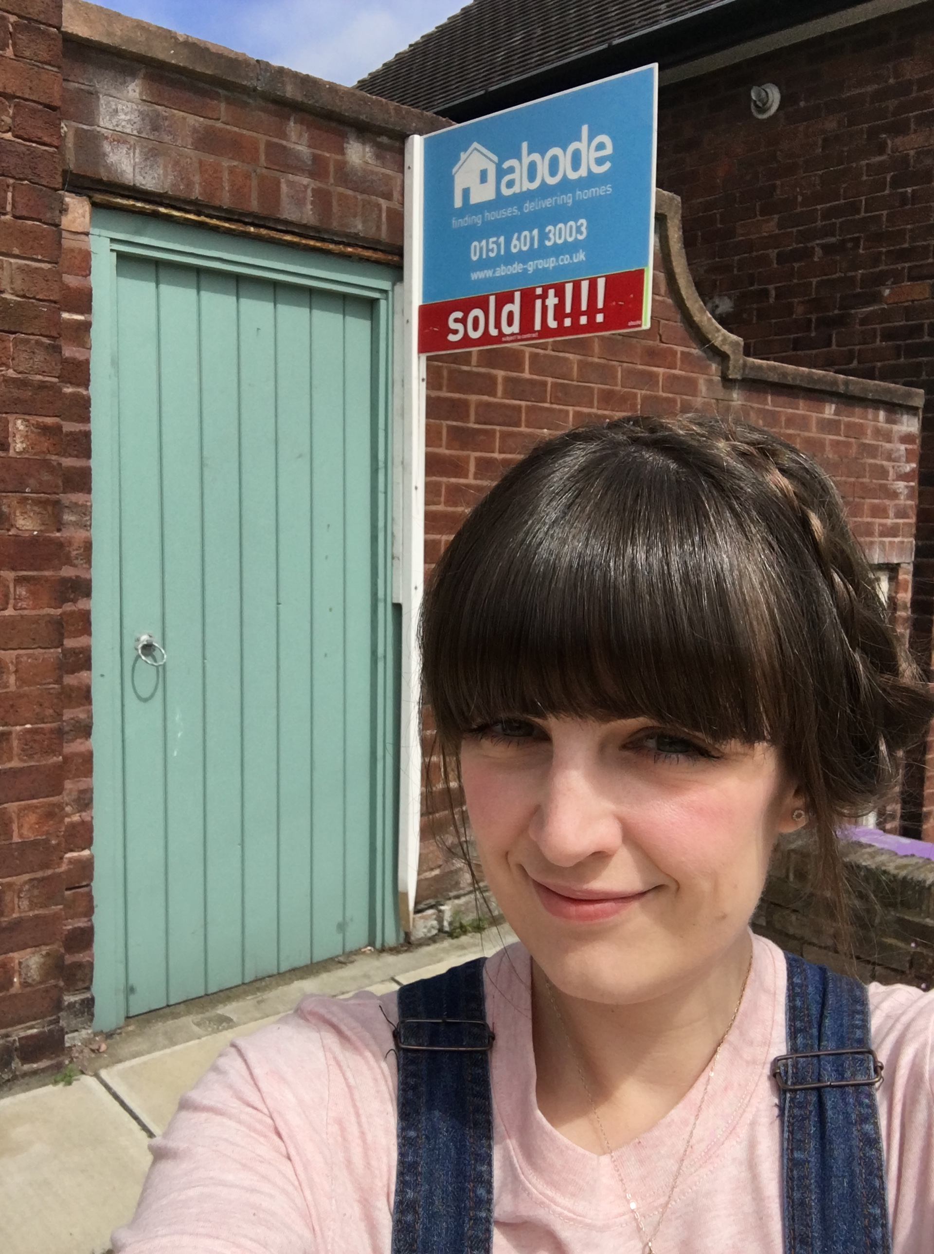 Me outside our old house and the SOLD sign on the day we moved. Goodbye little house!