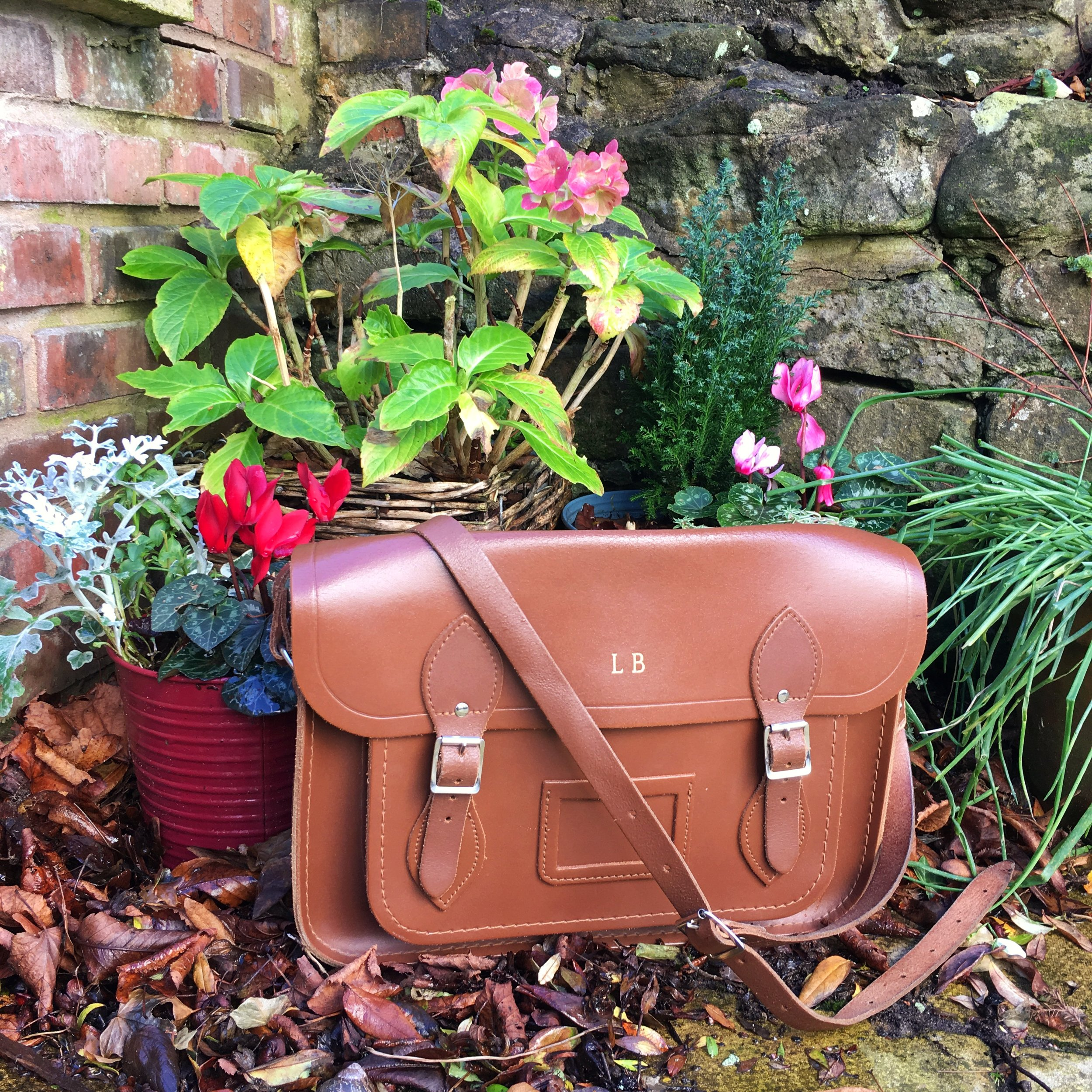 Cambridge satchel amidst autumn flowers and leaves. Pinafores and Peonies