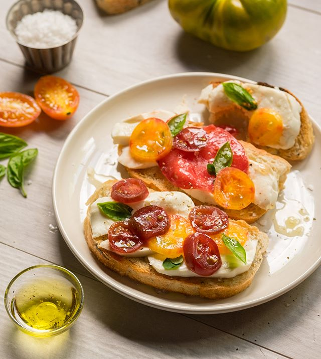 Every year at the end of summer @donovanwitmer likes to buy a few #heirloomtomatoes and bring them into the studio and see where they lead him. This year: caprese toasts on Thom's rosemary olive oil bread. Thanks @lemonstmarket, @thomsbread and @lancasterfarmfresh for the beautiful produce. @premisestudio  #premisestudiophoto