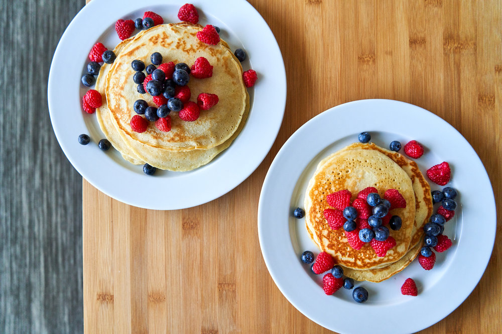 Sourdough Pancakes/Waffles | What To Do With Discard Sourdough - pancakes decorated with berries | In Carina's Kitchen