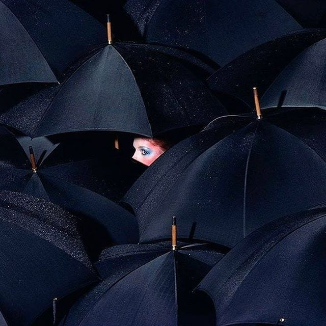 """In Tokyo people don't really own umbrellas. You'll see a stand in the entrance to block of flats or public buildings filled with umbrellas which you help yourself to and drop off at the next place you're going. Why don't we do this in London, the rainiest of rainy cities?! Photo by @guybourdinofficial . """"#guybourdin 1970  Copyright The Guy Bourdin Estate 2018 Courtesy of @louisealexandergallery""""  #londonlife #rainyday #moodyblues #umbrellas #fashionphotography #inspo #mood"""