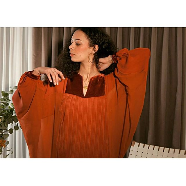 The Katarina dress is made from rich silk-mix velvet at the neck and cuffs, sheer silk georgette for the sleeves (all from unwanted fabric stocks) and organic bamboo stripe for the body.  Available at www.baue.co.uk/shop  Link in bio.  #sustainablefashion #ecofashion #ethicalfashion #fashionrevolution #orangedress #batwing #partydress #sustainabledress #ethicaldress #ecodress #colourful #colourpop