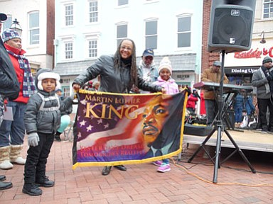The third Annual Martin Luther King, Jr. Memorial Parade was held in Annapolis on Jan. 16, 2017. Mayor Michael Pantelides participated in the parade, which was hosted by the City of Annapolis. In addition to a lineup of local officials, businesses, various organizations and bands, individuals of all ages participated in this year's celebration of love and unity. Helen Chambers, a well-respected leader and retired educator served as the parade's grand marshal. The parade's founder and this year's co-chair. Phyllis Tee Adams is pictured holding the Dr. Martin Luther King, Jr. banner. PHOTO BY ANDREA BLACKSTONE