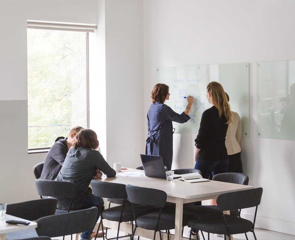 Group of employees brainstorming in an office