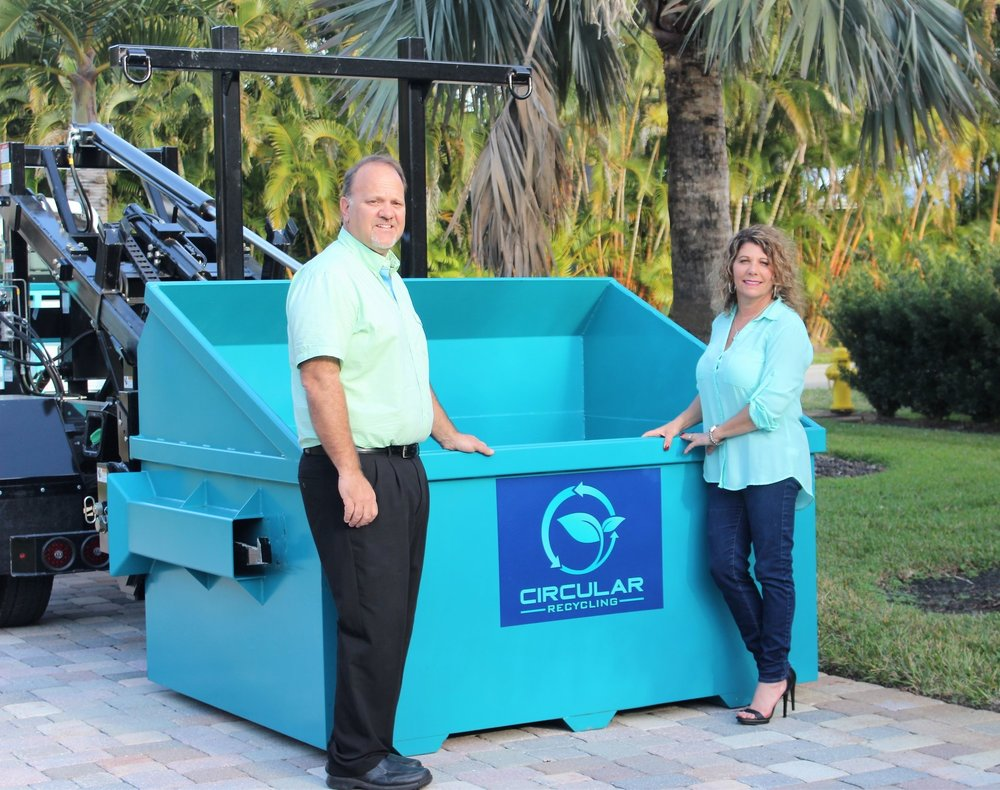 Lisa and Craig standing by one of their custom designed 4 yard containers. The low loading height and large capacity was designed with the customer in mind