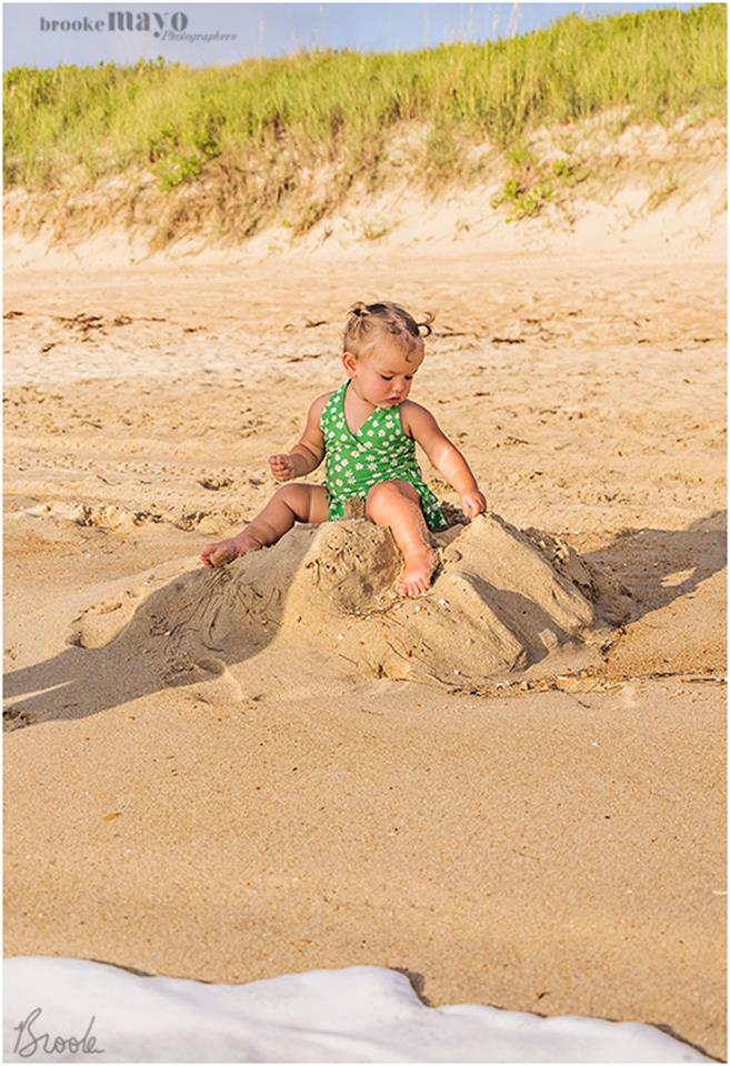 baby in the sand