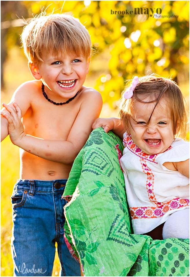 Siblings laughing