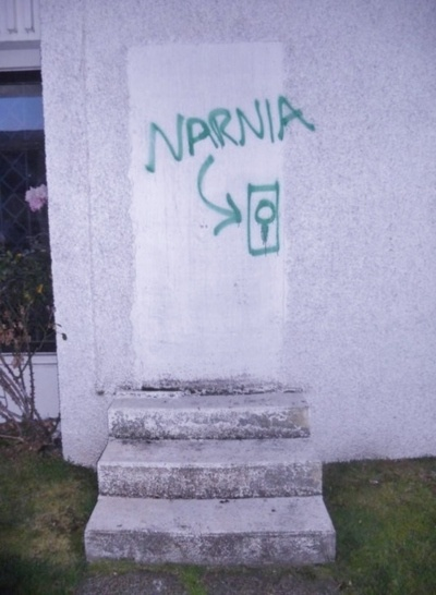 Bricked up doorway with Narnia sign.jpg