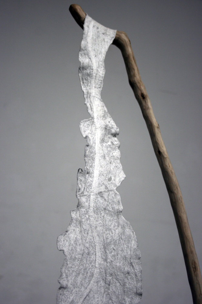 'Hanging by a thread'  Branch, thread, concrete  240 x 100 x 50 cm