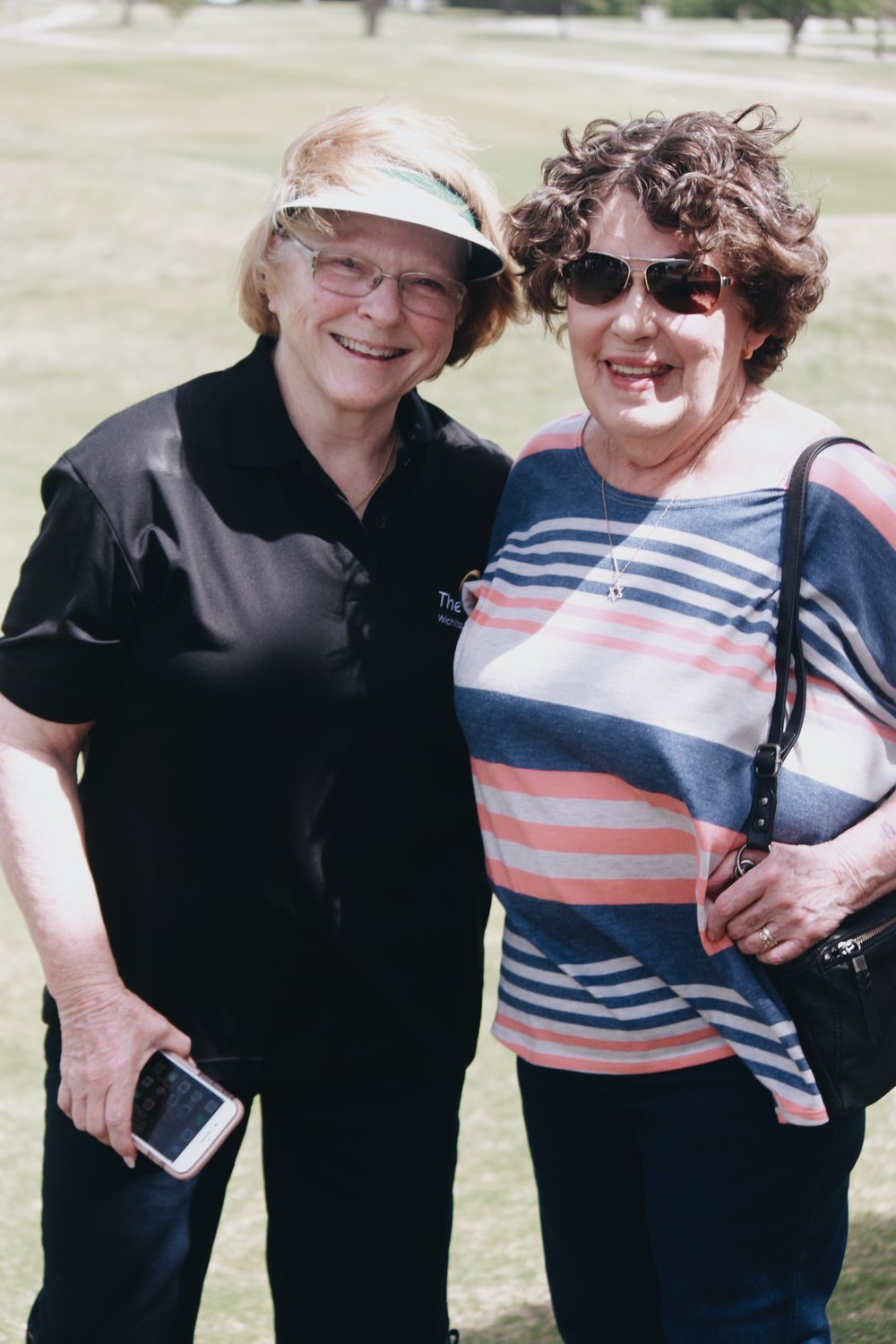 (left to right) Parent, Penney Denman, and previous Executive Director, Marlene Goldstein