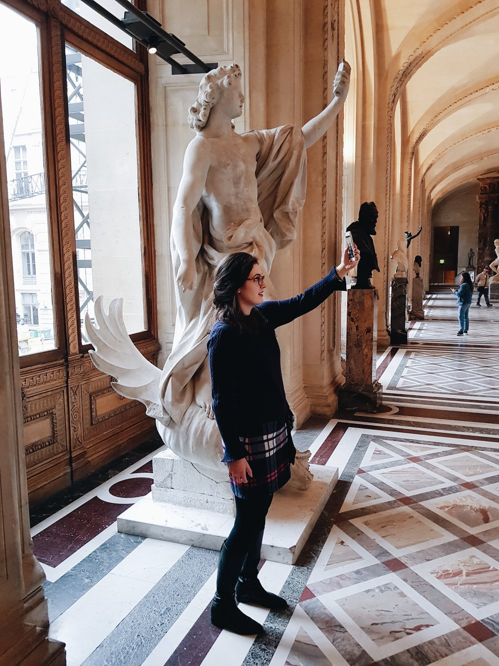 "Olivia Lindem with ""Apollo Sauroctonus"" at the Louvre."