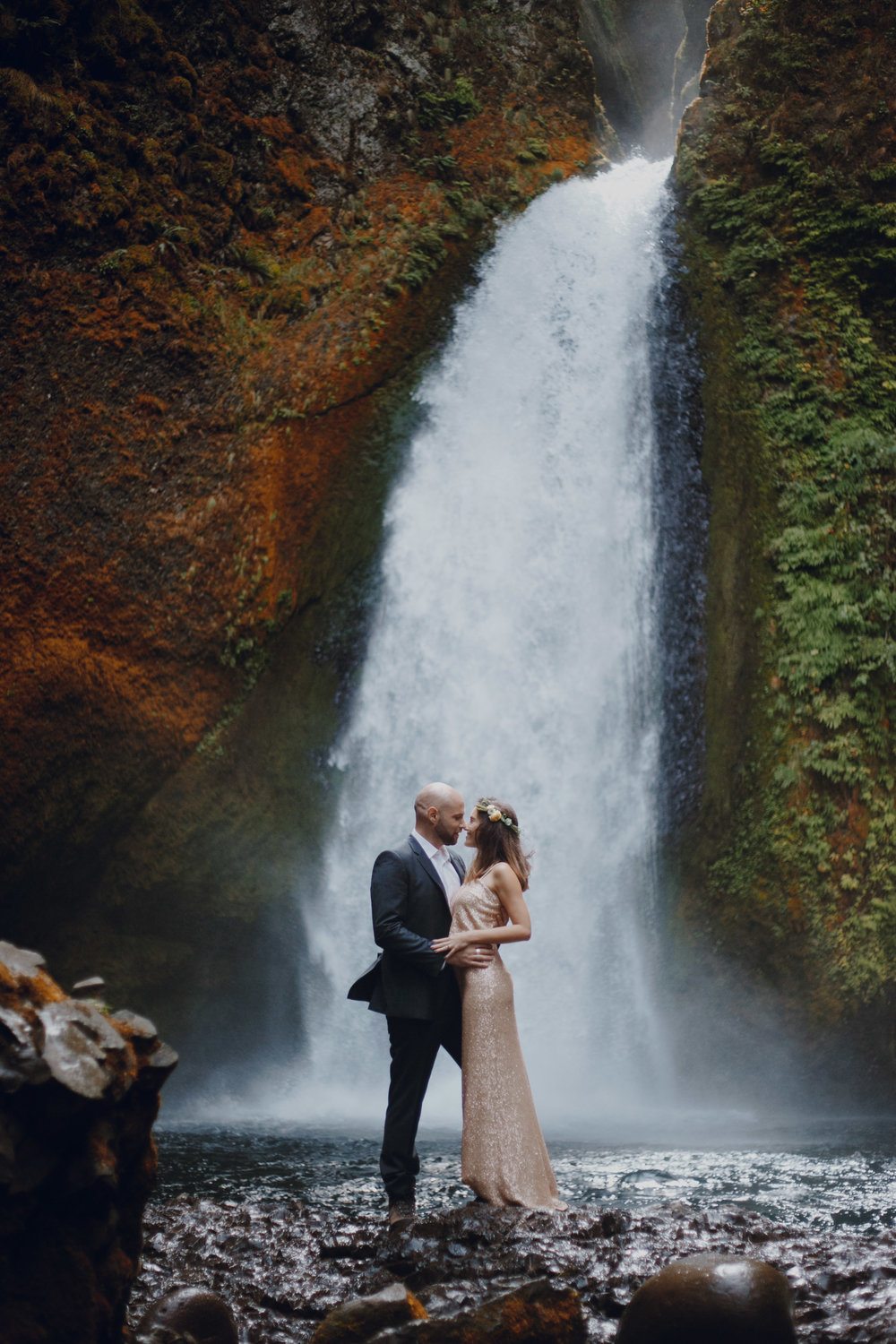 Couple getting married in front of the falls.