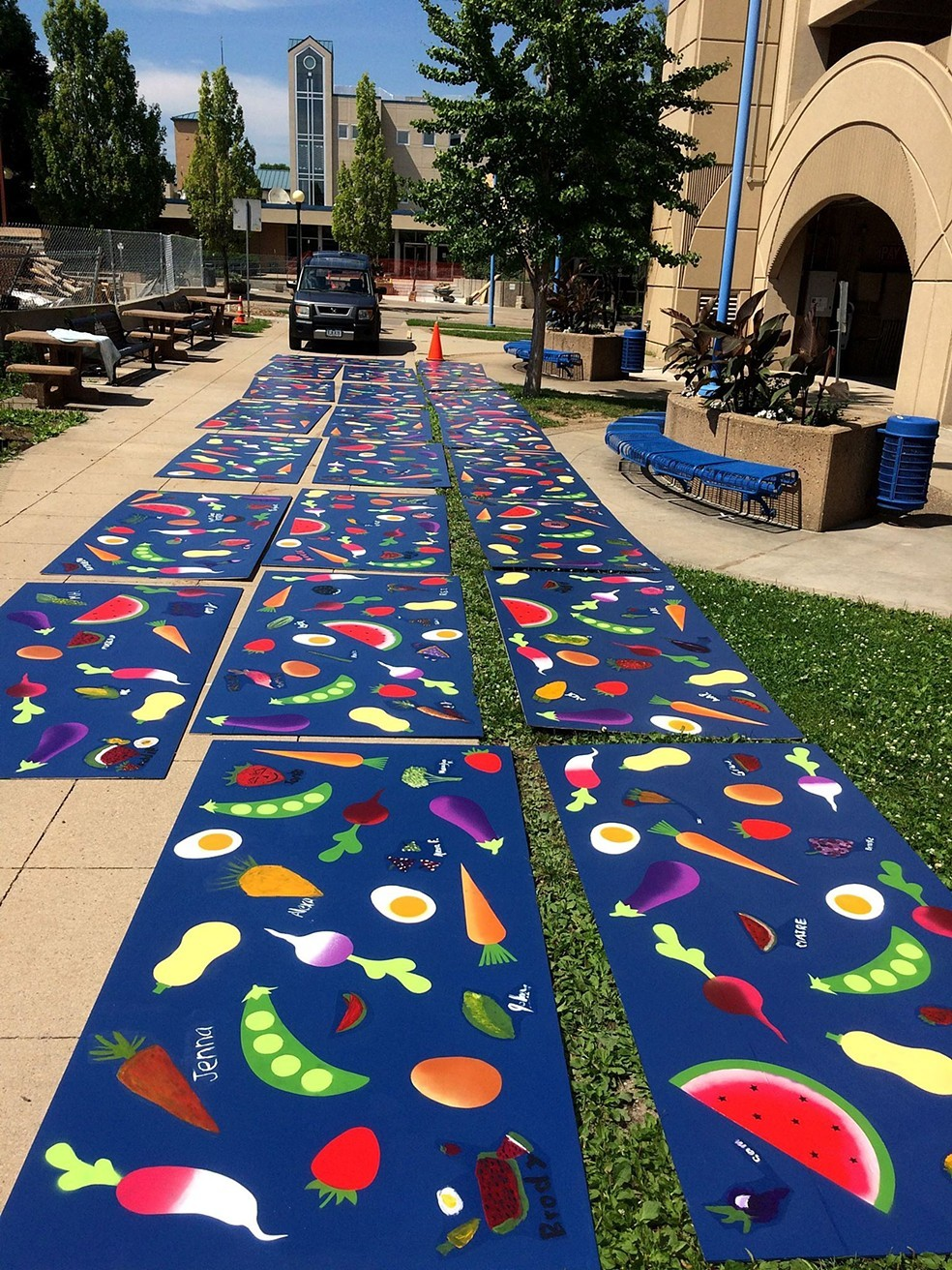 Community mural project for the Iowa City Farmers' Market. This piece included a few hundred participants whose paintings were later laminated to the surface as part of the piece. The rest of the work was stenciled around those paintings in the studio. 175' x 4' completed over the course of 3 weeks in June of 2017.