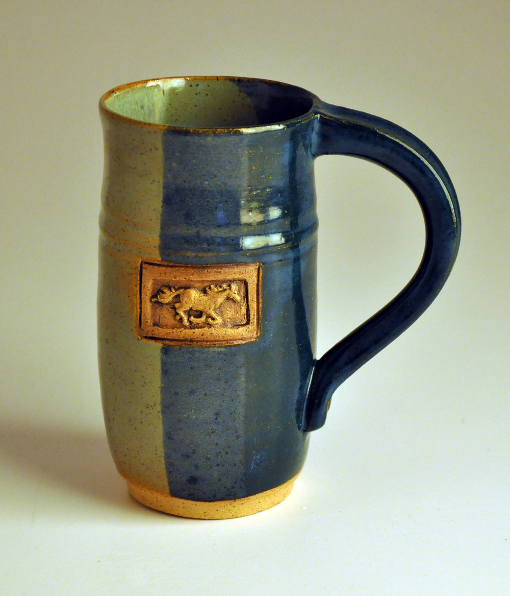 blue and green horse cup